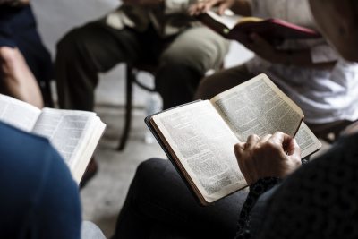 christian people reading bible together